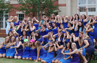 group of sorority gals in blue dresses on bid day