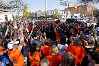 fans at toomer's corner celebrating a win