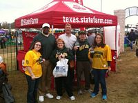 7 tailgaters at a state farm tent