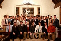 group of scores of kappa sigs posing in suits and ties