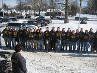 a seranade by 25 guys lined up in the snow
