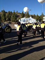 cal band marching to the stadium