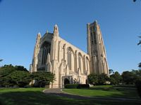 white limestone gothic Rockefeller Chapel with tall parapet steeple into a blue sky