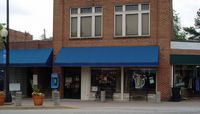 local bar (Tiger Town Tavern) with blue awning is campus favorite
