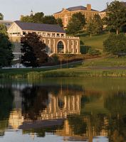 campus on a hill reflecting on a lake