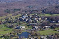 a view of the colgate campus from the air in the fall showing how remote it is and in the mountains