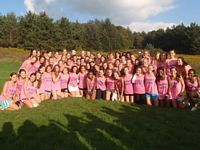 Kappas all in pink pose after rush in a field wearking pink ts