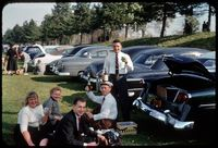 a classic 1954 tailgate party when the men wore ties to games and tailgating was on the lawn from a picnic basket