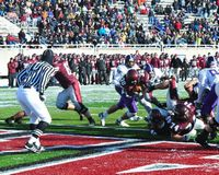 colgate runner scores as huge stadium crowd is in the background