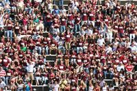 crimson tshirts prevail in this huge colgate crowd as 30 rows are pictured in the sun