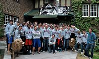 a gaggle of maybe 40 SAEs in Greek letered sweat shirts posing in fron of their chapter house