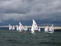 all the sail boats of the sailing team racing