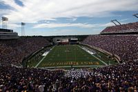 purple everywhere as this photo of the stadium endzone looks out on both two decked sides of the stadium