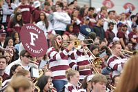 Pep band members play the fight song for the fans.