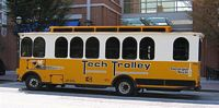 Tech Trolly is a yellow and Blue bus that looks like a trolly.