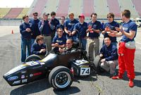 The Bosch Tech motorsports team poses at the track.