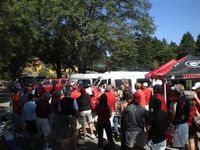 a wide shot of many tailgaters in Georgia colors