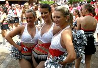 UGA uniformed twirlers from the band mix with tailgaters