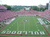 Sanford Stadium packed with red clad fans viewed from the endzone upper deck toward the scoreboard end