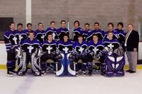 Pictured, on the ice, is the purple uniformed Holy Cross hockey club in full pads etc.