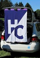 A tailgater had his mini van lid up with a purple and white HC flag draped down.