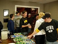 All the fraternities at Iowa tend to invite alumni back on game days and for them and parents have food.  Pictured are undergrads and alumni going through the chow line.