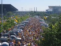 As far as this picture can see are Iowa yellow clad hawkeye tailgaters.