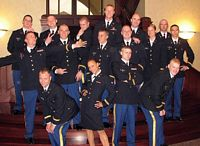 ROTC grads pose in humorous poses in Army Dress Blues