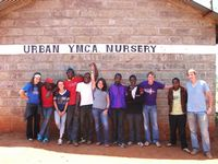 Students pose at YMCA nursery project.