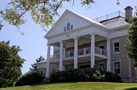 The Sigma Nu House is a stately southern mansion complete with white columns.