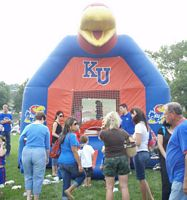 Tailgater's kids are playing in one of those blow-up moon walk things in Red and Blue with Jay Hawk graphics.