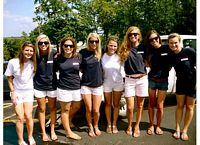 Sororities tailgate together for some games.  Here are 8 sisters in blue smiling at you in summer shorts and Ts.