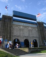 Ithis a picture of the stadium exterior with hugh walls and tunnel entrances.