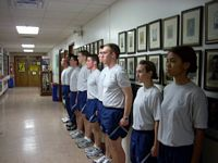 Here some guys and gals in ROTC do exercises.