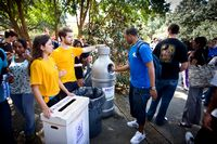 Students shown here are hicking off a campus recycle program.