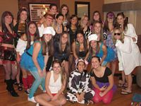 This group of pretty and smiling Alpa Phis seem to be in costumes.
