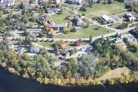 This is an aerial view of the campus on the river.