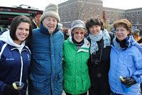 5 older alums bundled against the weather for a tailgate social time.