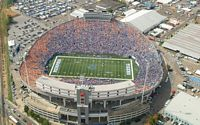 An aerial view of the Liberty Bowl Stadium and Memphis is playing Tennessee because the place is sold out and there are some sections of orange clad fans.