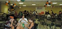 Pictured is a Christian Fellowship gathering and all are enjoying a buffet of food and fun.