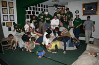 Lambda Chi brothers ll in green and gold.