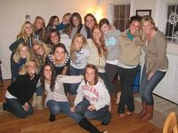 This group of Alpha Phis are posing before going out to a night event on campus.