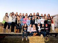 This group of Kappas are riding on a float that looks like a hay ride.
