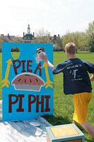"Here is a guy hitting a Pi Phi in their charity event called ""Pie a Pi Phi""."