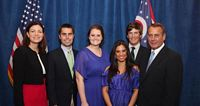Miami students hapily pose with GOP speaker of the house Boehner.