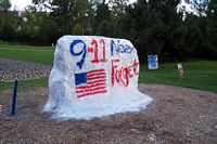 "The rock gets painted often and this time it says ""9 - 11 We'll Not Forget'."