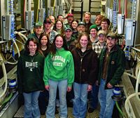 Here are ag school milkers all smiling at you in a group photo.