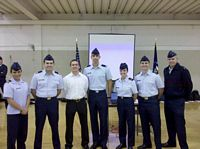 ROTC cadets of the Air Force pose all smiles in summer dress uniforms.