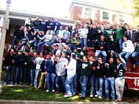 Here are 60 Pikes outside their house on a firetruck.