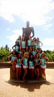 This gouop of lovely Pi Phis are all posing around the spartan statue like a big tall soft Christmas tree in powder blue all smiles.